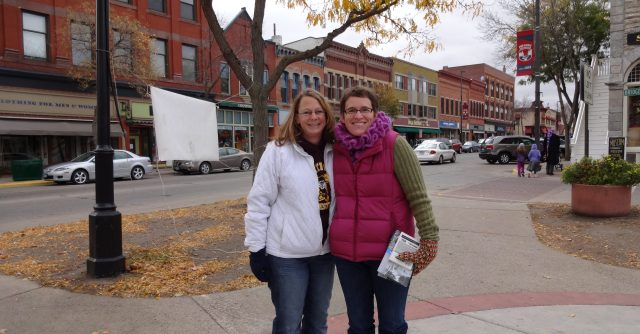 """Downtown Northfield with two United Way representatives holding brochures"""