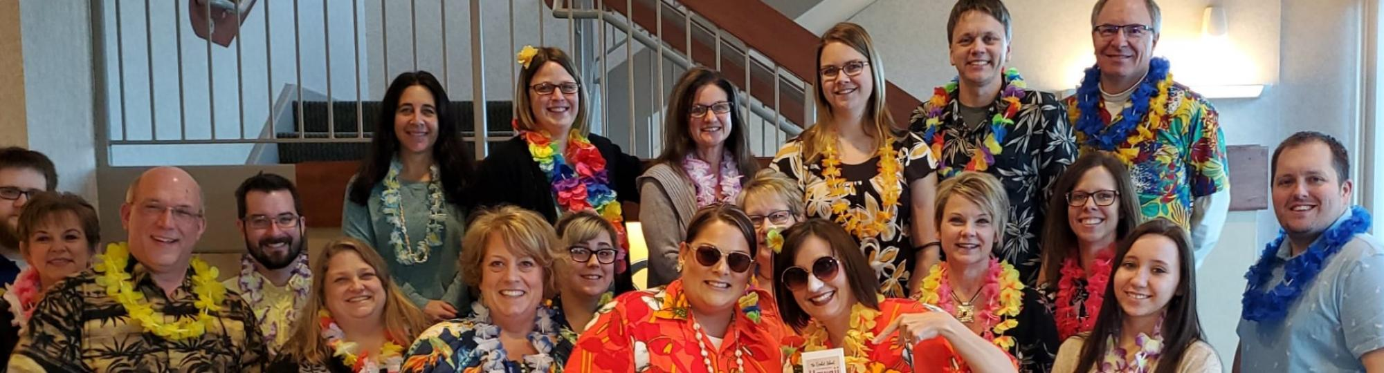 Community Resource Bank staff celebrate Hawaiin day of their United Way campaign - wearing tropical shirts and colorful leis