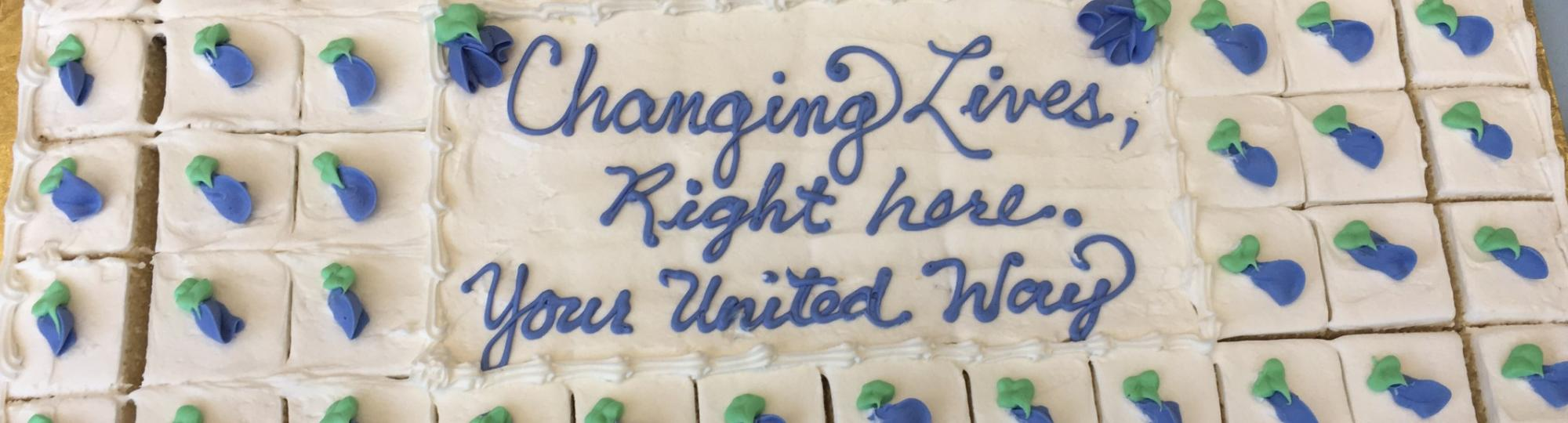 Cake with writing that says Changing Lives, Right Here. Your United Way.