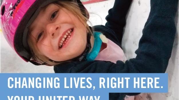 Girl with bright pink helmet clings to wall at ice rink. Text reads: Changing Lives, Right Here. Your United Way.