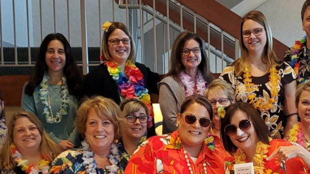 Bank employees enjoy their United Way campaign in Hawaiian shirts and leis